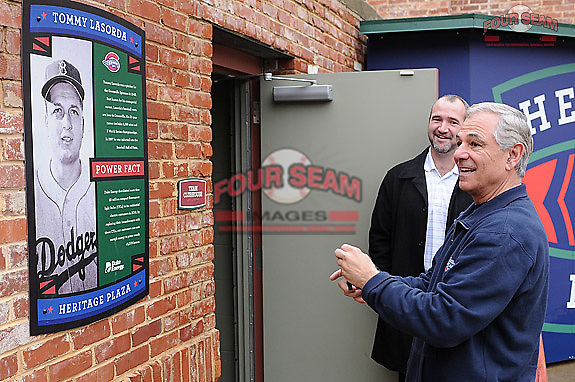 New Boston Red Sox manager Bobby Valentine takes a photo with his cell phone of the Tommy Lasorda plaque on January 23, 2012, at Fluor Field at the West End in Greenville, South Carolina. Behind Valentine is Greenville Drive General Manager Mike deMaine. Valentine was in town to speak at the annual Greenville Drive Hot Stove Event.