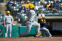 Tyler Doanes (1) of the West Virginia Mountaineers follows through on his swing against the Illinois Fighting Illini at TicketReturn.com Field at Pelicans Ballpark on February 23, 2020 in Myrtle Beach, South Carolina. The Fighting Illini defeated the Mountaineers 2-1.  (Brian Westerholt/Four Seam Images)