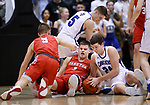 February 28, 2020; Yankton at St. Thomas More High School Basketball -- Ryder Kirsch #24 of St. Thomas More tries to get possesion of a loose ball during a scramble with Trevor Fitzgerald #3 Yankton during their game Friday evening at Barnett Arena in Rapid City, S.D.(Photo by Richard Carlson/Inertia)
