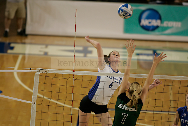 UK's Lauren Rapp attempts the kill against Michigan State at Memorial Coliseum on Friday, Dec. 4, 2009. Rapp let the team with 14 kills to help the Cats defeat the Spartans in the first round of NCAA tournament play. Photo by Scott Hannigan | Staff
