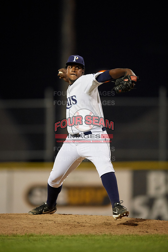 Princeton Rays relief pitcher Juan Carlos Arias (20) delivers a pitch during the second game of a doubleheader against the Johnson City Cardinals on August 17, 2018 at Hunnicutt Field in Princeton, Virginia.  Princeton defeated Johnson City 12-1.  (Mike Janes/Four Seam Images)