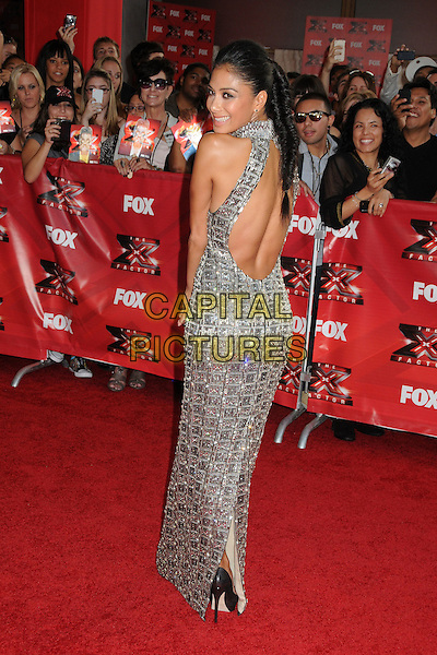 "Nicole Scherzinger.""The X Factor"" World Premiere Screening Event held at the Cinerama Dome, Hollywood, California, USA..September 14th, 2011.full length grey gray silver sleeveless beads beaded sequins sequined dress backless back behind rear looking over shoulder fishtail plait braid hair  .CAP/ADM/BP.©Byron Purvis/AdMedia/Capital Pictures."