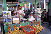Fruits juice vendor at work