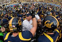 California head coach Jeff Tedford huddle together before going back to the locker room before 115th Big Game against Stanford at Memorial Stadium in Berkeley, California on October 20th, 2012.  Stanford defeated California, 21-3.