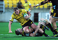 Toby Smith is tackled during the Super Rugby quarterfinal match between the Hurricanes and Chiefs at Westpac Stadium in Wellington, New Zealand on Friday, 20 July 2018. Photo: Dave Lintott / lintottphoto.co.nz