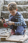 Berkeley CA Boy, five, using drill on carpentry project  MR