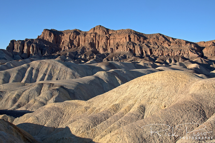 The eroded badlands of Zabriskie Point, in the Amargosa Range near Furnace Creek in Death Valley National Park, is composed of sediments from Furnace Creek Lake, which dried up 5 million years ago -- long before Death Valley came into existence.