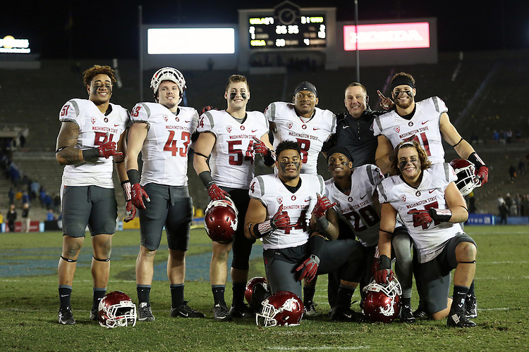 Frankie Luvu, Aaron Porter, Nate DeRider, Jeremiah Allison, Isaac Dotson, Chandler Leniu, Paris Taylor and Peyton Pelluer, Washington State University linebackers, pose for a photo with WSU linebackers coach, Ken Wilson, following the Cougars Pac-12 conference road game against the UCLA Bruins at the Rose Bowl in Pasedena, California, on November 14, 2015.  In a closely fought battle throughout, WSU defeated the Bruins by scoring a touchdown in the final 3 seconds to win it, 31-27.
