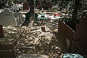 Baby Falak's graveyard (centre) marked with a stone slab sits in-between two other graves in a graveyard behind the media HQs in ITO, New Delhi, India. Photo: Sanjit Das/Panos