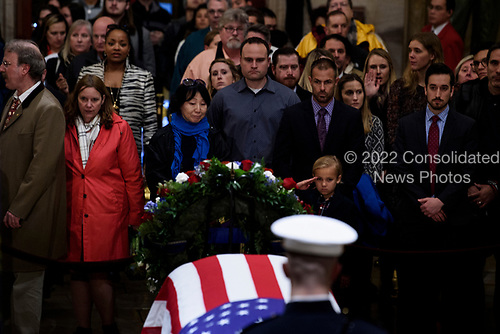 Stephen G. Leighton Jr. salutes while paying respects with his father  Stephen G. Leighton Sr. as the remains of former US President George H. W. Bush lie in state in the US Capitol's rotunda December 3, 2018 in Washington, DC.