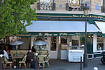 Man at a cafe in the 4th arrondisement of Paris, France