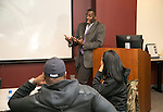 Leodis Scott talks about future assignments with  Fraternal Order of Police students in the Educational Leadership Ed.D. program Tuesday, Feb. 28, 2017, at the university library in the Loop Campus, (DePaul University/Jamie Moncrief)