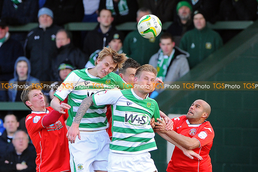 Dan Burn of Yeovil Town and Byron Webster of Yeovil Town challenge for a header - Yeovil Town vs Walsall - NPower League One Football at Huish Park, Yeovil, Somerset - 29/03/13 - MANDATORY CREDIT: Denis Murphy/TGSPHOTO - Self billing applies where appropriate - 0845 094 6026 - contact@tgsphoto.co.uk - NO UNPAID USE.