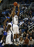 Nevada's Deonte Burton shoots over Air Force defender Justin Hammonds during an NCAA basketball game in Reno, Nev., on Saturday, Feb. 1, 2014. Nevada won 69-56 in overtime. (AP Photo/Cathleen Allison)