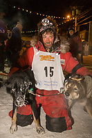 Lance Mackey poses with his dogs at the finish of the 2008 All Alaska Sweepstakes in Nome. Mackey took third place and arrived with a damaged sled and injured dog named Zoro, due to a snow machine collision about 20 miles from the finish line.