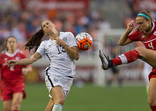 21.02.2016. Houston, TX, USA.  Canada Defender Shelina Zadorsky (4) with a high kick towards USA Forward Alex Morgan (13) during the Women's Olympic qualifying soccer final match between Canada and USA at BBVA Compass Stadium in Houston, Texas.
