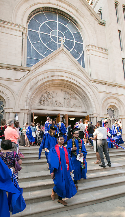 Graduates exit the Saint Vincent de Paul Parish Church on DePaul University's Lincoln Park Campus following the Baccalaureate Mass Friday, June 10, 2016. The event was part of the 118th commencement ceremonies for the Chicago university. (DePaul University/Jamie Moncrief)