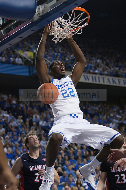 UK forward Alex Poythress dunks during the second half of the University of Kentucky men's basketball game vs. Belmont University at Rupp Arena in Lexington, Ky., on Saturday, December 21, 2013. Kentucky defeated Belmont 93-80. Photo by Michael Reaves | Staff.