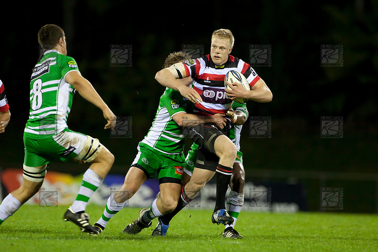 Baden Kerr fights his way forward through the Manawatu defenders. ITM Cup rugby game between Counties Manukau and Manawatu played at Bayer Growers Stadium on Saturday August 21st 2010..Counties Manukau won 35 - 14 after leading 14 - 7 at halftime.