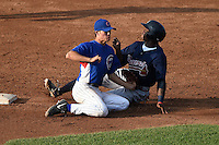 Cameron Comer (30) of Olentangy Liberty High School in Powell, Ohio playing for the Chicago Cubs scout team tags out Alonzo Jones Jr sliding in during the East Coast Pro Showcase on July 31, 2014 at NBT Bank Stadium in Syracuse, New York.  (Mike Janes/Four Seam Images)