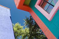 Brightly colored buildings in La Placitas Village.
