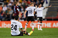 1st February 2020; Mestalla, Valencia, Spain; La Liga Football,Valencia versus Celta Vigo; Ezequiel Garay of Valencia CF asks the Referee Pablo Gonzalez to stop the game after being injured