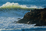 Powerful ocean waves breaking next to coastal rocks, Pescadero State Beach, San Mateo County coast, California