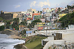 La Perla is a slum neighborhood aside of the northern historic city wall of Old San Juan, Puerto Rico, stretching about 600 meters along the rocky Atlantic coast immediately east of the Santa Maria Magdalena de Pazzis Cemetery and down the slope from (north of) Calle Norzagaray...La Perla was established in the late 19th century. Initially, the area was the site of a slaughterhouse because the law required them and homes of former slaves and homeless non white servants - as well as cemeteries - to be established away from the main community center; in this case, outside the city walls. Some time after, some farmers and workers started living around the slaughterhouse and shortly established their houses there.
