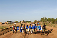 UGANDA, Karamoja, Karimojong tribe, children going home from school by walking