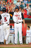 Lansing Lugnuts pinch runner Josh Almonte (26) high fives Chris Carlson (3) after scoring on a home run hit by Tim Locastro (not shown) during a game against the Peoria Chiefs on June 6, 2015 at Cooley Law School Stadium in Lansing, Michigan.  Lansing defeated Peoria 6-2.  (Mike Janes/Four Seam Images)