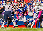 12 October 2014: Buffalo Bills running back Anthony Dixon gains 3 yards in the first quarter against the New England Patriots at Ralph Wilson Stadium in Orchard Park, NY. The Patriots defeated the Bills 37-22 to move into first place in the AFC Eastern Division. Mandatory Credit: Ed Wolfstein Photo *** RAW (NEF) Image File Available ***