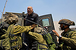 Israeli soldiers try to bundle a Palestinian protester into an army jeep following his arrest during a non-violent demonstration in the West Bank village of An Nabi Salih near Ramallah on 09/07/2010.