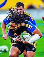 Ma'a Nonu warms up during the Super Rugby match between the Hurricanes and Rebels at Westpac Stadium, Wellington, New Zealand on Friday, 13 March 2015. Photo: Dave Lintott / lintottphoto.co.nz