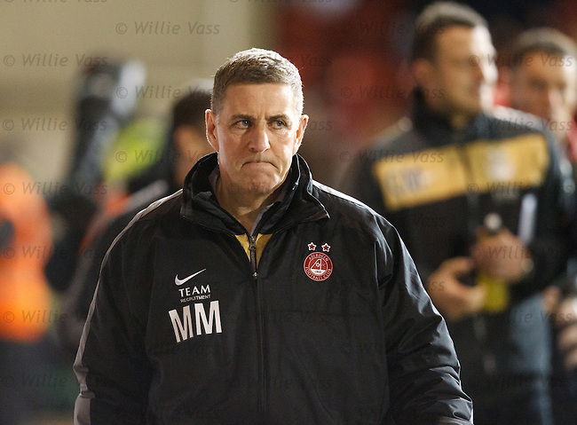 Mark McGhee departs the pitch at half time and a goal down