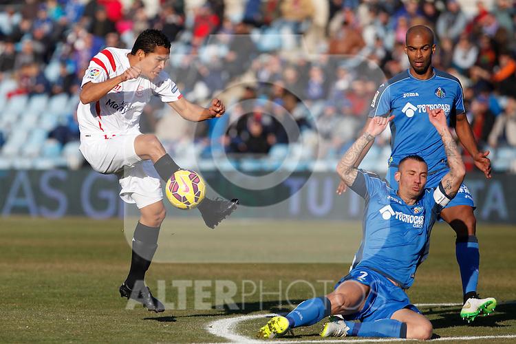 Getafe´s Alexis and Naldo and Sevilla´s Bacca during 2014-15 La Liga match at Alfonso Perez Coliseum stadium in Getafe, Spain. February 08, 2015. (ALTERPHOTOS/Victor Blanco)
