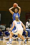 27 October 2013: Kendall McCravey-Cooper (behind) is guarded by Tricia Liston (32). The Duke University Blue Devils played their annual preseason Blue White women's college basketball game at Cameron Indoor Stadium in Durham, North Carolina.