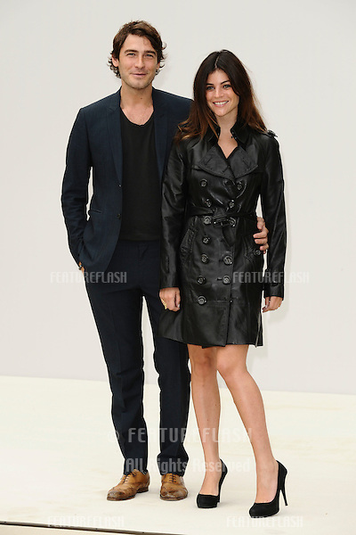 Robert Konjic and Julia Restoin Roitfeld arrives for the Burberry Prorsum SS'12 catwalk show in Kensington Gardens as part of London Fashion Week..19/09/2011  Picture by Steve Vas/Featureflash