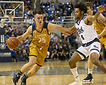 California Baptist guard Ty Rowell (25) drives past Nevada's Nisre Zouzoua (5) in the second half of an NCAA college basketball game in Reno, Nev., Monday, Nov. 19, 2018. (AP Photo/Tom R. Smedes)