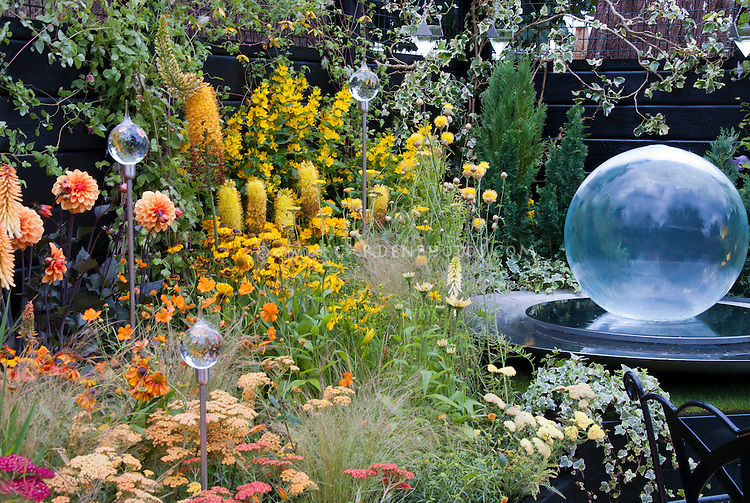 Yellow And Orange Color Theme Garden With Glass Globe Ornament, Glass  Gazing Ball, Glass