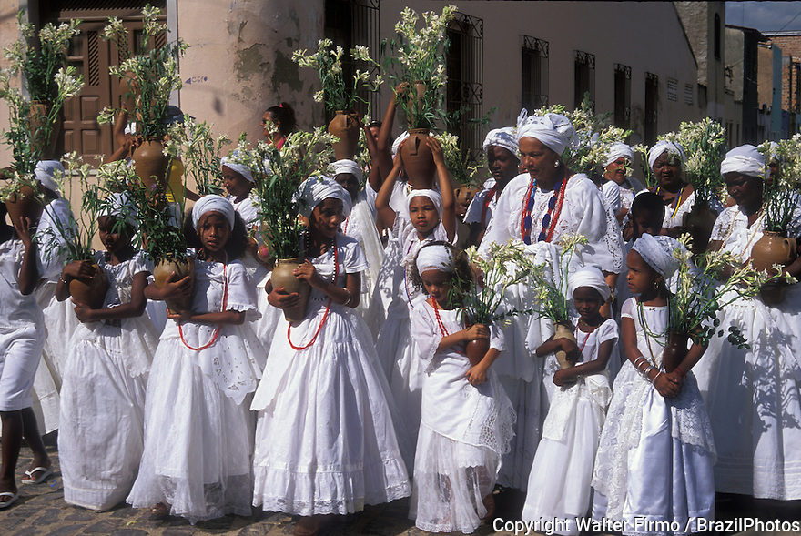 Religion. Festa de Nossa Senhora da Purificação, celebrated at Santo Amaro city; State: Bahia; Brazil. Afro-brazilian religious rituals, Baianas take flowers ( offerings ), procession, lavagem da escadaria ( church washing ).
