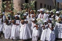 Religion. Festa de Nossa Senhora da Purificação, celebrated at Santo Amaro city; State: Bahia; Brazil. Afro-brazilian religious rituals, Baianas take flowers ( offerings ), procession, lavagem da escadaria ( church washing ).