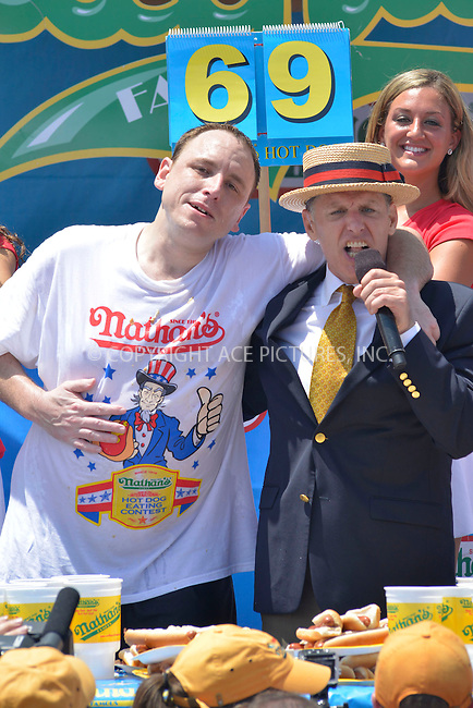 WWW.ACEPIXS.COM . . . . . <br /> July 4, 2013...New York City....JDick D. Zigun  and Joey &quot;Jaws&quot; Chestnut  at Nathan's Hotdog Eating Contest in Coney Island on  July 4, 2013 in New York City. ....Please byline: CURTIS MEANS - WWW.ACEPIXS.COM.. . . . . . ..Ace Pictures, Inc: ..tel: (212) 243 8787 or (646) 769 0430..e-mail: info@acepixs.com..web: http://www.acepixs.com