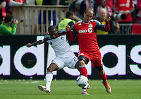17 September 2011: Colorado Rapids midfielder Sanna Nyassi #23 and Toronto FC defender Mikael Yourassowsky #19 in action during a game between the Colorado Rapids and Toronto FC at BMO Field in Toronto..Toronto FC won 2-1.