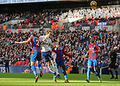 5th November 2017, Wembley Stadium, London England; EPL Premier League football, Tottenham Hotspur versus Crystal Palace; Harry Kane of Tottenham Hotspur heads the ball over Joel Ward and Jeffrey Schlupp of Crystal Palace for an attempted goal effecting during the 1st half