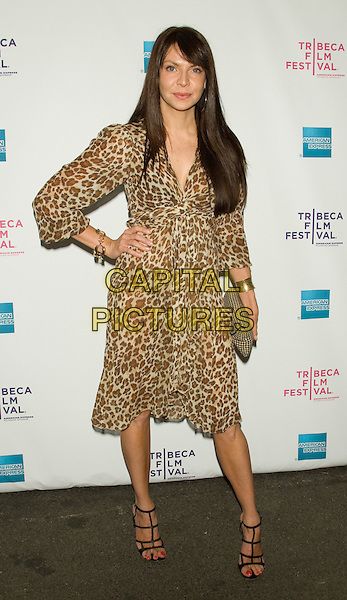 """CYIA BATTEN.2008 Tribeca Film Festival - Premiere of """"Killer Movie"""" at the AMC 19th Street Theater, New York, NY, USA..April 24th, 2008.full length brown leopard print dress hand on hip clutch bag.CAP/LNC/TOM.©TOM/LNC/Capital Pictures."""
