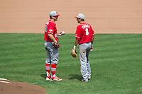 North Carolina State Wolfpack shortstop Trea Turner #8 talks with pitcher Carlos Rodon #16 during Game 3 of the 2013 Men's College World Series between the North Carolina State Wolfpack and North Carolina Tar Heels at TD Ameritrade Park on June 16, 2013 in Omaha, Nebraska. The Wolfpack defeated the Tar Heels 8-1. (Brace Hemmelgarn/Four Seam Images)