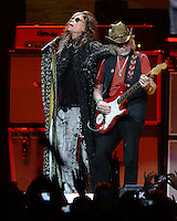 SUNRISE, FL - DECEMBER 09:  Steven Tyler and Brad whitford of Aerosmith perform at the BB&T Center on December 9, 2012 in Miami.  Credit: mpi04/MediaPunch Inc. /NortePhoto