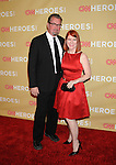 HOLLYWOOD, CA. - November 21: Chris Haston and actress Kate Flannery attend the 2009 CNN Heroes Awards held at The Kodak Theatre on November 21, 2009 in Hollywood, California.