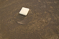 Second base on a freshly dragged field during summer baseball league