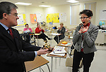 ShopKo's Mike MacDonald, left, surprises Washington Middle School teacher Karen Janke at her school on March 12, 2009 with the announcement that she has been chosen as a Golden Apple award winner. Janke teaches seventh and eighth grade social studies and AVID (Advancement Via Individual Determination).